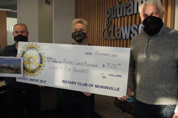 lawyers donating a cheque